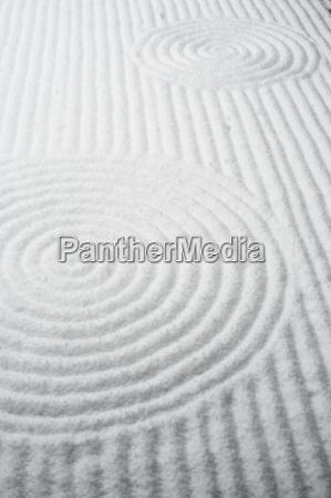 patterns in snow covered rock garden