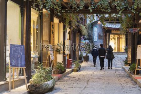 people walking through street lijiang unesco
